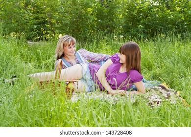 Mom and daughter at a picnic