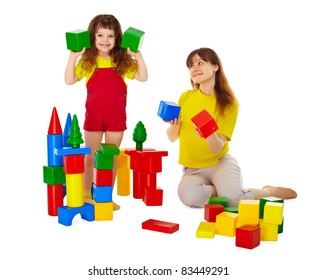 Mom and daughter playing with blocks isolated on white background