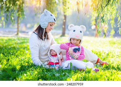 Mom and daughter playing in the park.