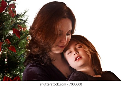 Mom and Daughter pose next to the Christmas tree