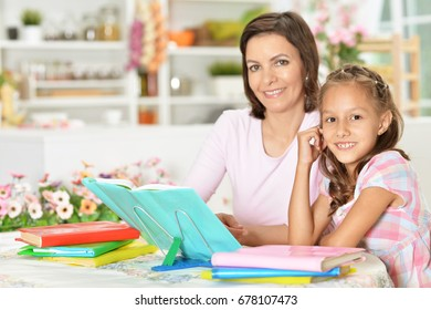 Mom and daughter read books