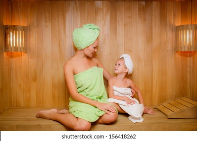 Mom and daughter relax in the sauna. relaxation.