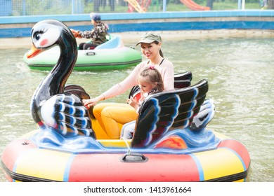 Mom and daughter ride on the water attraction
