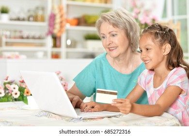 Mom and daughter are shopping on the Internet