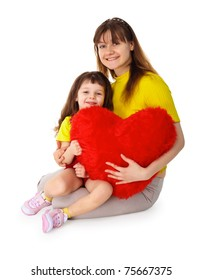 Mom and daughter sit with a toy heart in his hands isolated on white background