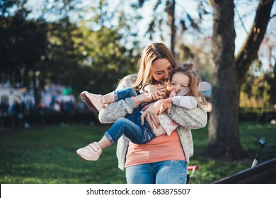 Mom and daughter spend time together in the park