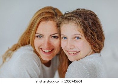 Mom and daughter teenager spend time together / portrait of mom with daughter / copy space