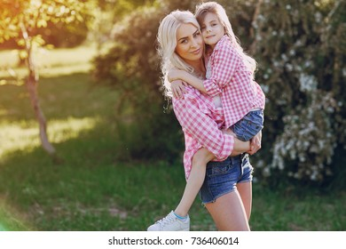 mom and daughter walk in the Park