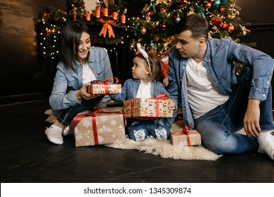 Mom gives a festive gift to her little daughter
