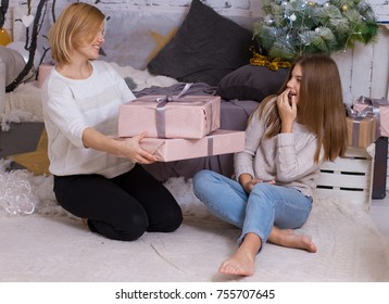 Mom gives gifts to her daughter, New Year's concept