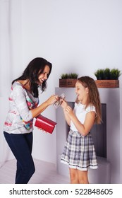 Mom gives pocket money a child. The concept of family and lifestyle
