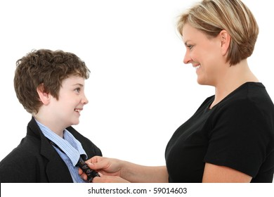 Mom helping adorable american 10 year old boy fix his tie in baggy over sized suit over white.