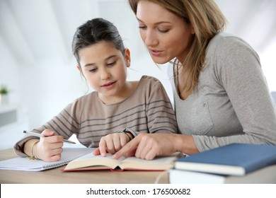 Mom helping kid with homework