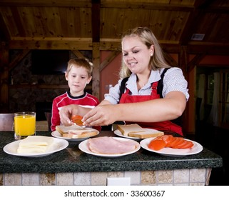 A mom helps her child make lunch.