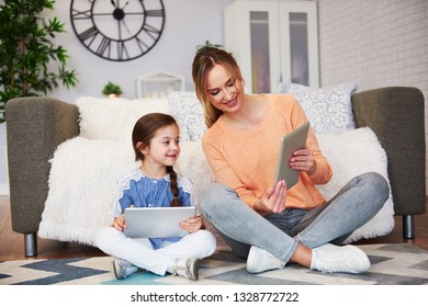 Mom and her child looking at digital tablet