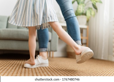 Mom and her daughter child girl are dancing. Family holiday and togetherness.