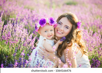 Mom and her daughter in a lavender field