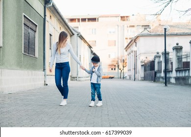 Mom and her son walking in a city