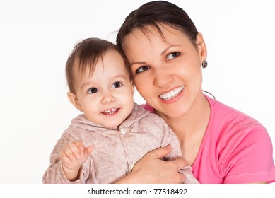 mom holds a baby on a white background