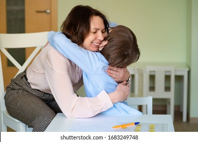 mom hug son to do homework. the teacher deals with a boy.