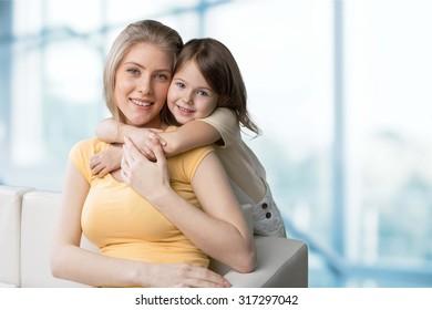 Mom hugging.