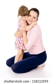 mom hugging with a small, beautiful child isolated on white background