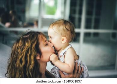 mom hugs and kisses little son