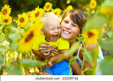 Mom with a little boy in sunflowers