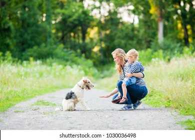 Mom and little daughter with fox terrier dog