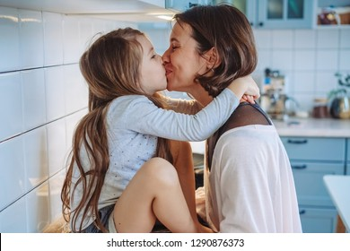 Mom and little daughter having fun together in the kitchen