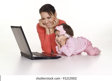 mom and little daughter with laptop on white