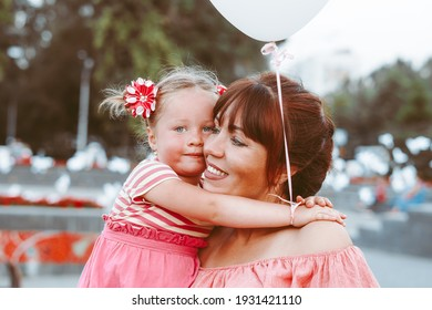 mom and little daughter in the park