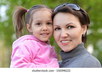 mom with a little girl in pink on a walk