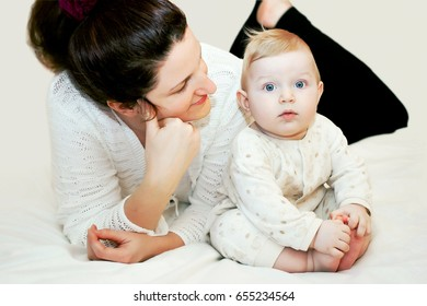 Mom is looking at cute baby