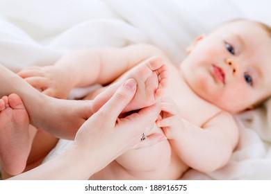 mom makes baby foot massage. isolation