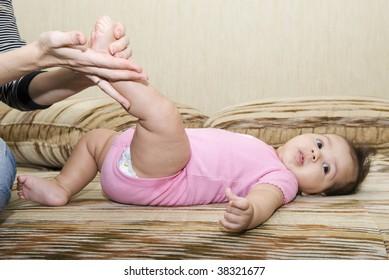 mom makes baby massage