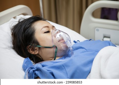 Mom in mask oxygen after childbirth