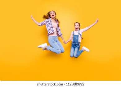 Mom mum mommy maternity two people best friendship upbringing rejoicing concept. Full length size portrait of cheerful joyful stylish modern relatives jumping up in air isolated on bright background