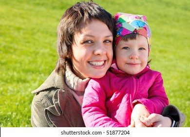 Mom playing with her toddler daughter in the outdoor