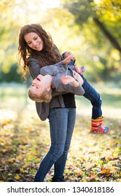 Mom playing with son outside