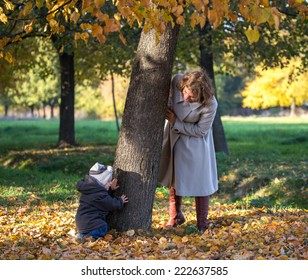 Mom plays with her little son in the park