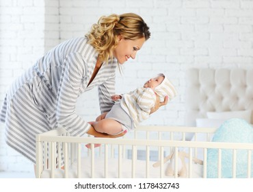 Mom puts her baby to bed 2 months in bed