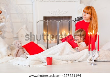 mom reading bedtime stories for her son christmas eve tales of the fireplace - Christmas Bedtime Stories
