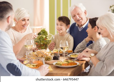 Mom smiling and putting salad on a plate