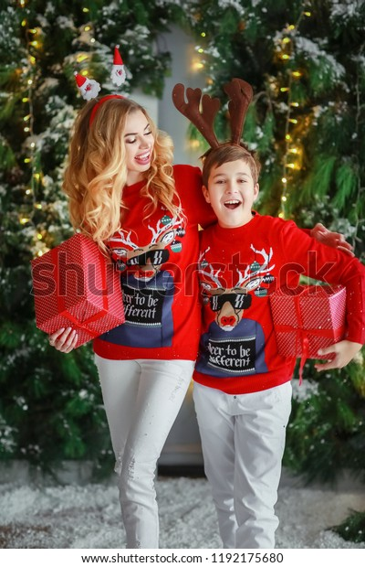 Christmas Gifts For Mom From Son.Mom Son Christmas Presents Stock Photo Edit Now 1192175680