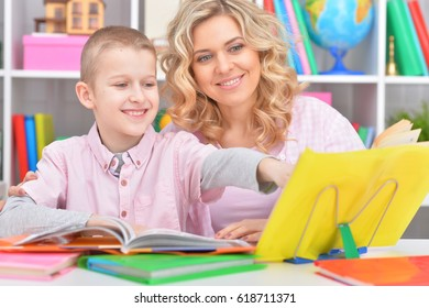 Mom and son  doing lessons