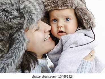 Mom and son in fur hats