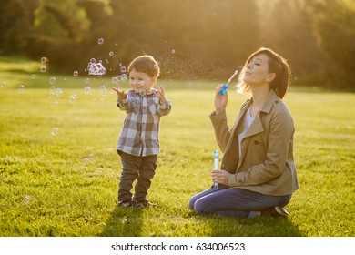 Mom and son have fun and make balloons from soap