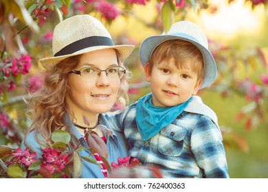 Mom and son have fun in the park. Tenderness, hugs and joy outside the room. Mothers Day.
