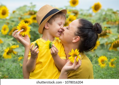 Mom And Son Hug Laugh And Play In A Field Of Sunflowers Happy Family